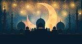 Mosque silhouette in night sky with crescent moon and star