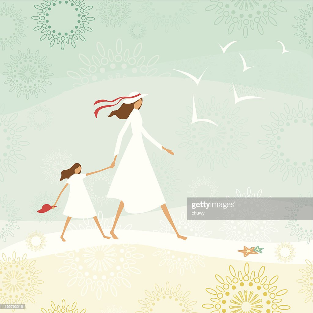 Mother and daughter walking through the beach