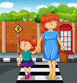 Mother and girl crossing the road