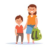 Mother and son elementary schoolboy go to school