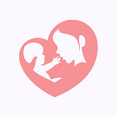 Mother holding little baby in heart shaped silhouette