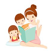Mother Reading Tale Book To Daughter And Son