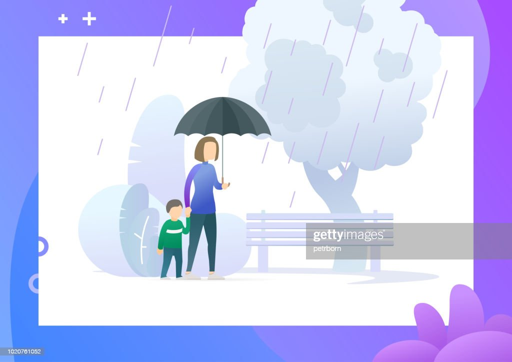 Mother walking under umbrella with her child.