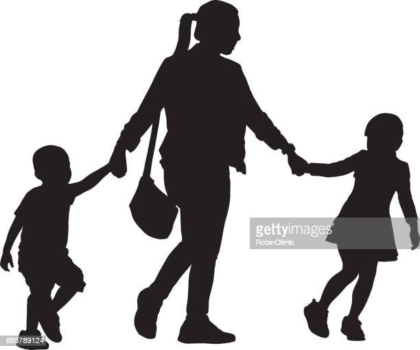 Mother Walking With Son And Daughter