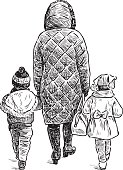 mother with her kids on a walk
