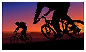 Mountain biking during a sunset
