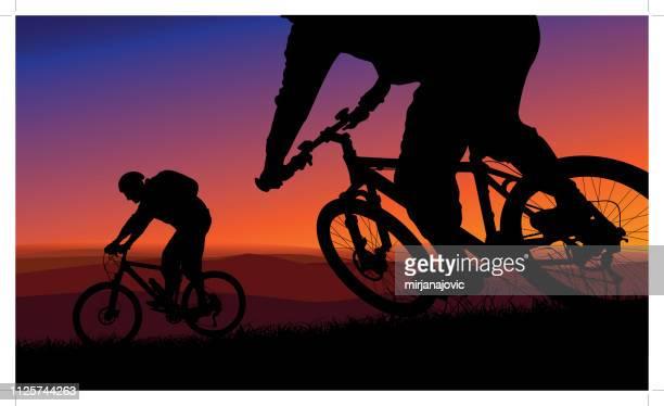 ilustrações de stock, clip art, desenhos animados e ícones de mountain biking during a sunset - mountain bike