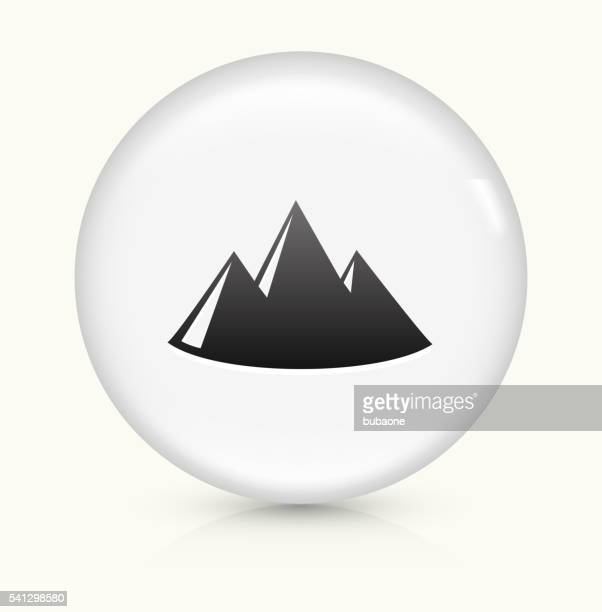 mountain icon on white round vector button - steep stock illustrations, clip art, cartoons, & icons