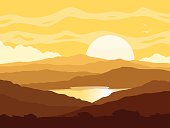 Mountain landscape with yellow sunset