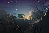mountaineer camping on hill in deep wood when night