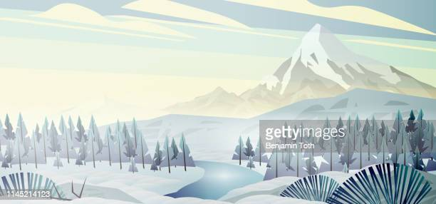 Mountains landscape at winter with pine forest near a lake