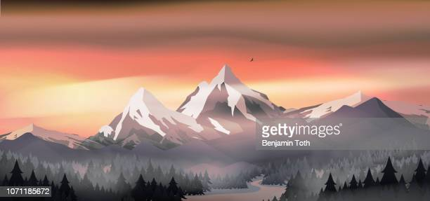Mountains landscape sunset with pine forest near a lake