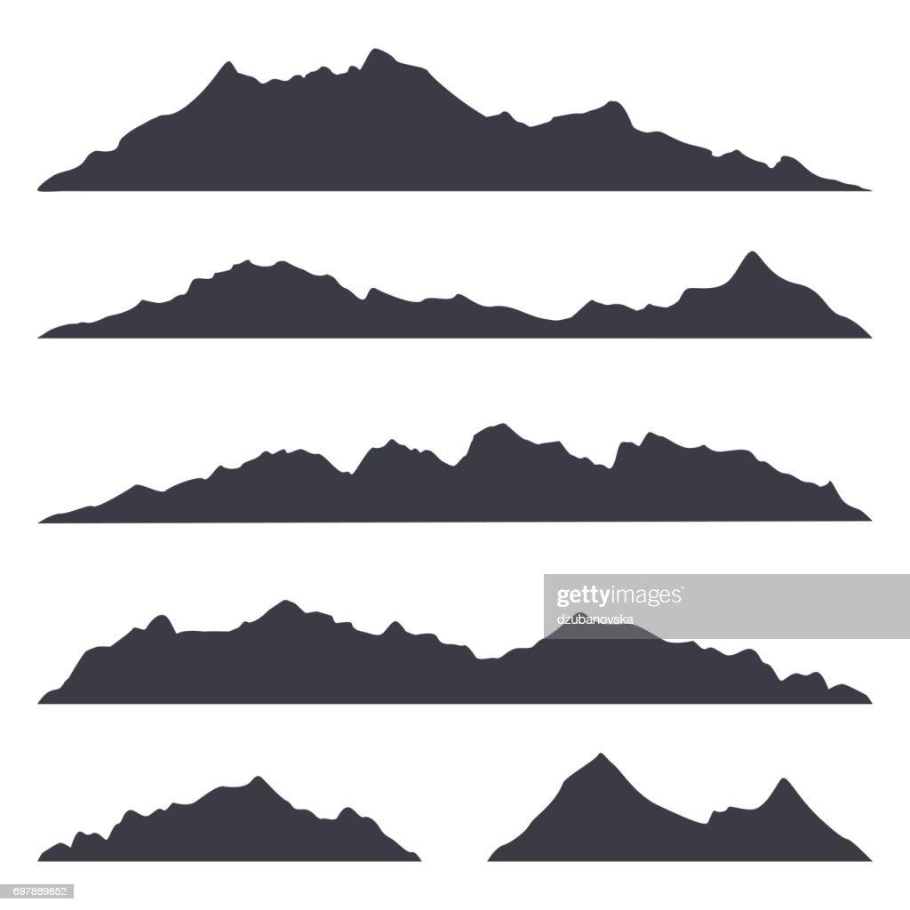 Mountains silhouettes on the white background
