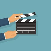 Movie clapper board hold in hand