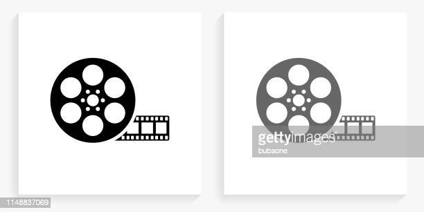 movie reel black and white square icon - film industry stock illustrations