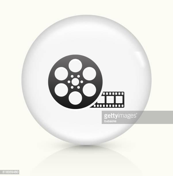 ilustraciones, imágenes clip art, dibujos animados e iconos de stock de carrete de película, icono sobre blanco, vector de redondo botón - rollo de cine