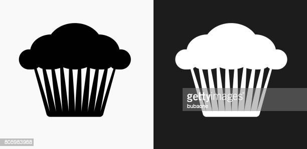 muffin icon on black and white vector backgrounds - muffin stock illustrations, clip art, cartoons, & icons