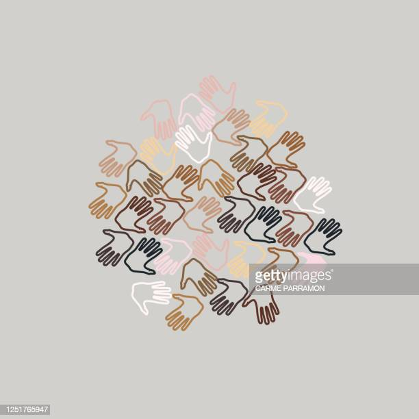 multi ethnic world. love and skin tones in a hand - multiculturalism stock illustrations