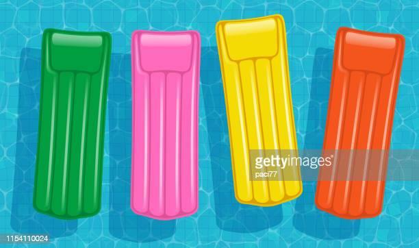 bunte luftmatratzen-vector - schwimmen stock-grafiken, -clipart, -cartoons und -symbole