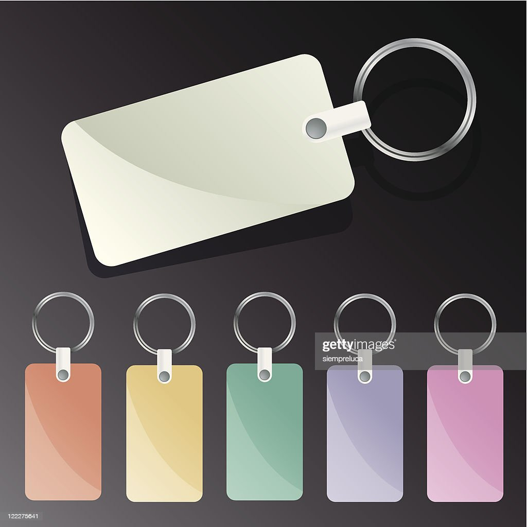 Multicolored blank keychain tags on black background