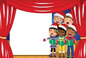 Multicultural kids singing Christmas carol nativity play stage copyspace