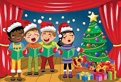 Multicultural kids xmas hat singing Christmas carol nativity play stage