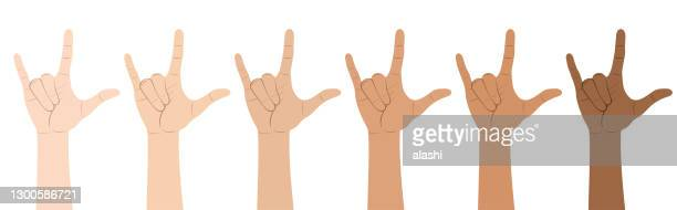 multi-ethnic hands show love in american sign language - i love you stock illustrations