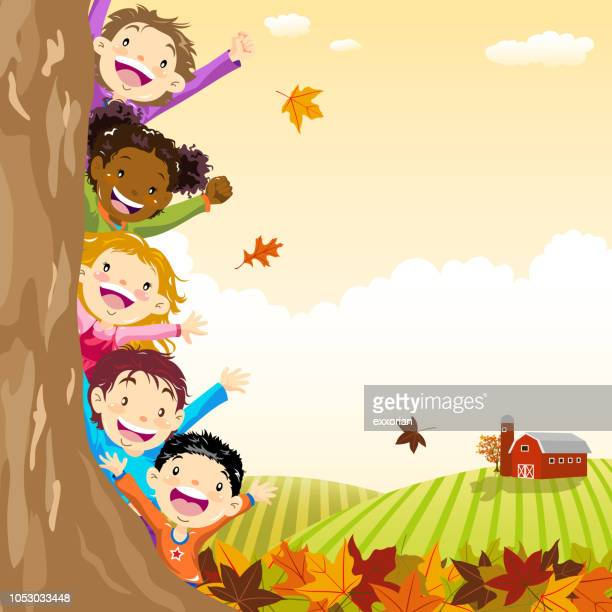 multi-ethnic kids hiding behind autumn tree - naughty america stock illustrations, clip art, cartoons, & icons