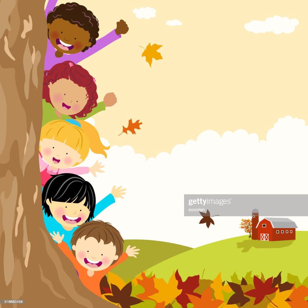 Multi-Ethnic Kids Hiding Behind Tree at Autumn