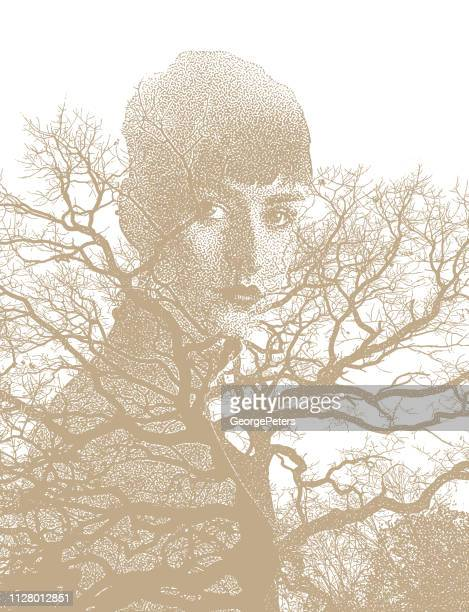 Multiple exposure image of woman morphing into trees