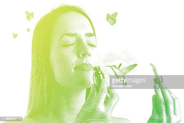 ilustraciones, imágenes clip art, dibujos animados e iconos de stock de exposición múltiple de una joven que huele aceites esenciales con colibrí - olores agradables
