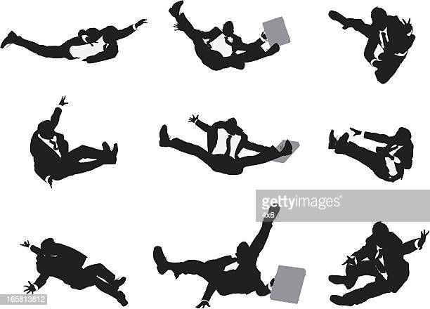 Multiple images of a businessman falling down