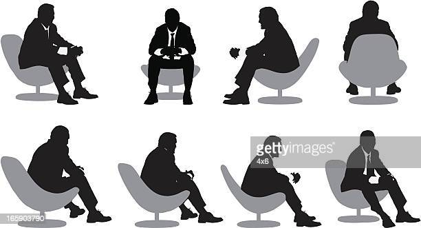 Multiple images of a businessman sitting on chair