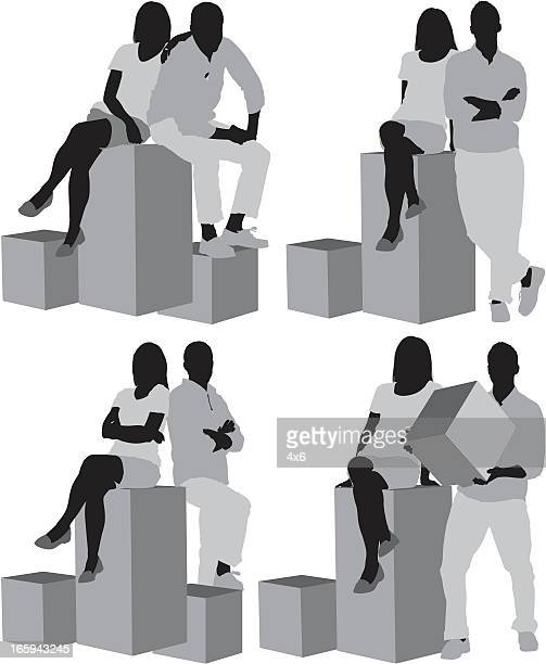 Multiple images of a couple with boxes