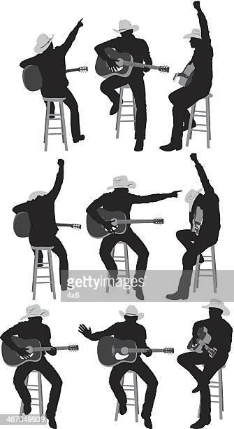 ilustraciones, imágenes clip art, dibujos animados e iconos de stock de varias imágenes de un tocando la guitarra vaquero - puntear un instrumento