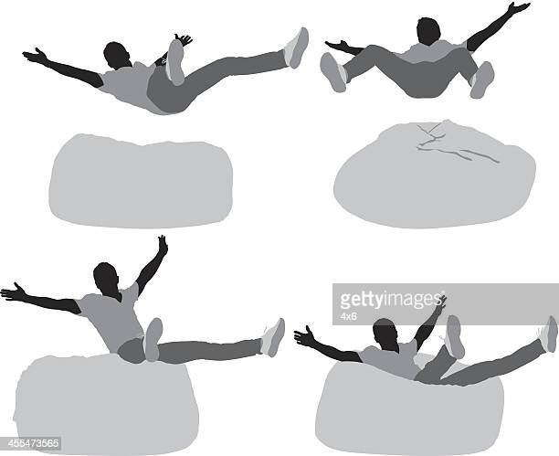 Multiple images of a man falling on bean bag
