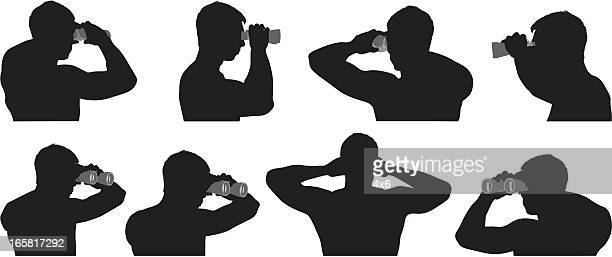 Multiple images of a man looking through binoculars