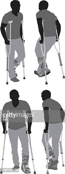 Multiple images of a man walking on crutches