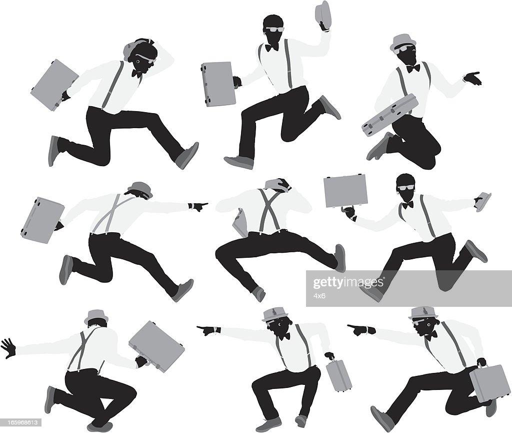 mehrere bilder von m nnern jumping mit einem koffer. Black Bedroom Furniture Sets. Home Design Ideas