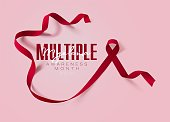 Multiple Myeloma Awareness Calligraphy Poster Design. Realistic Burgundy Ribbon. March is Cancer Awareness Month. Vector
