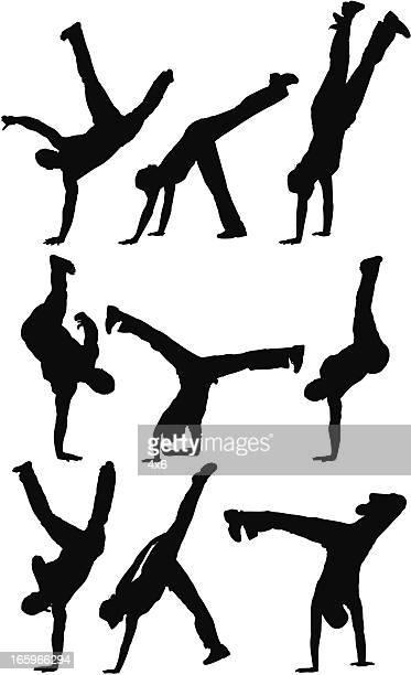 ilustrações de stock, clip art, desenhos animados e ícones de várias silhuetas de pessoas a praticar capoeira - capoeira