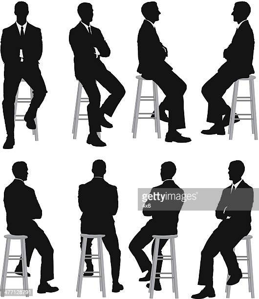 multiple silhouettes of a businessman sitting - sitting stock illustrations