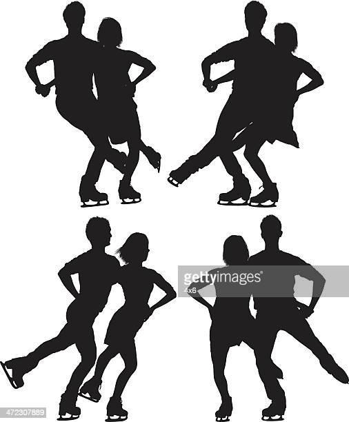 シルエットカップルの複数のアイススケート