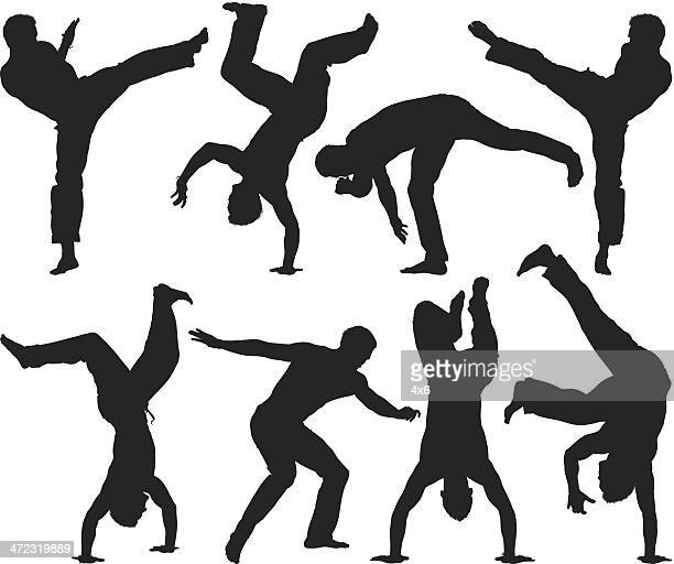 Multiple silhouettes of a man practicing capoeira