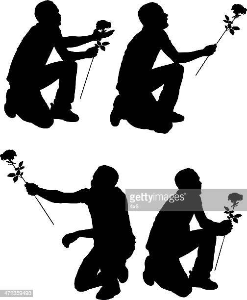 Multiple silhouettes of a man with flower