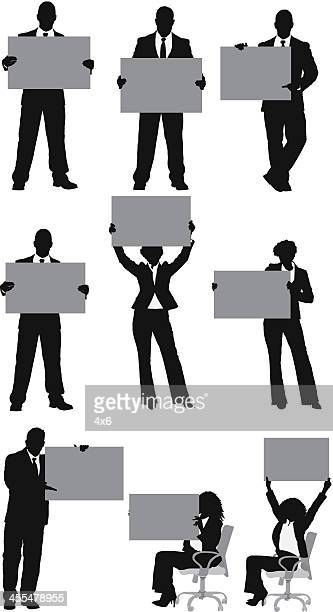 multiple silhouettes of business people with placard - holding stock illustrations, clip art, cartoons, & icons