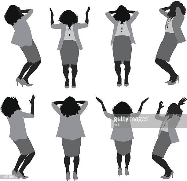 Multiple silhouettes of businesswoman gesturing