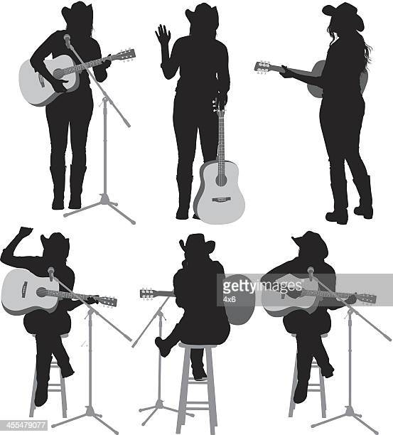 multiple silhouettes of cowgirl with guitar - guitarist stock illustrations, clip art, cartoons, & icons