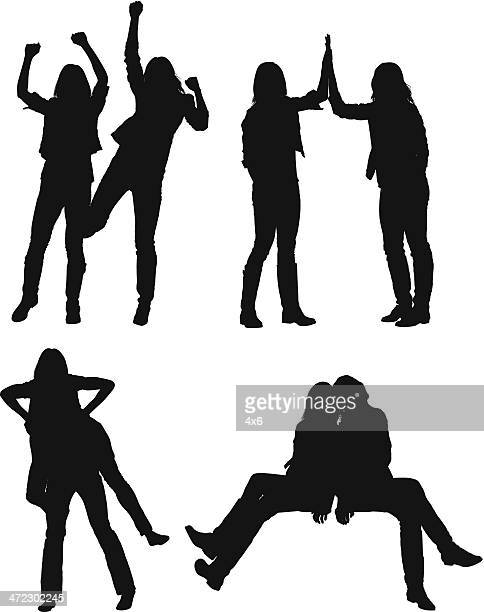 Multiple silhouettes of female friends posing