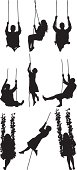 Multiple silhouettes of people on rope swing